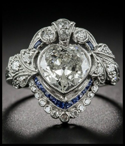 Edwardian sapphire and diamond ring with a 1.20 carat heart shaped center diamond.