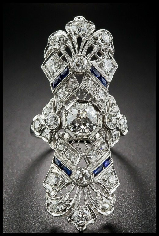 Front view of a beautiful antique Art Deco dinner ring at Lang Antiques. Sapphires and diamonds in platinum filigree, circa 1920s.