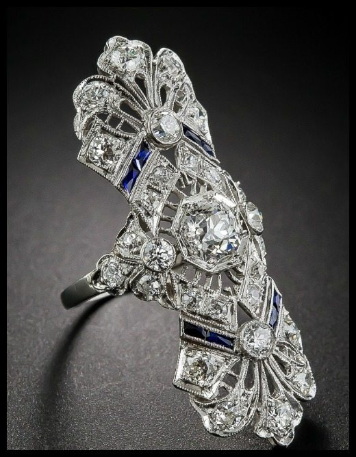 Shoulder view of a beautiful antique Art Deco dinner ring at Lang Antiques. Sapphires and diamonds in platinum filigree, circa 1920s.