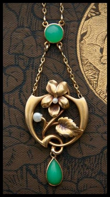 This antique Art Nouveau necklace features a beautiful floral design and the fabulous green stone, chrysoprase. At Trademark Antiques.