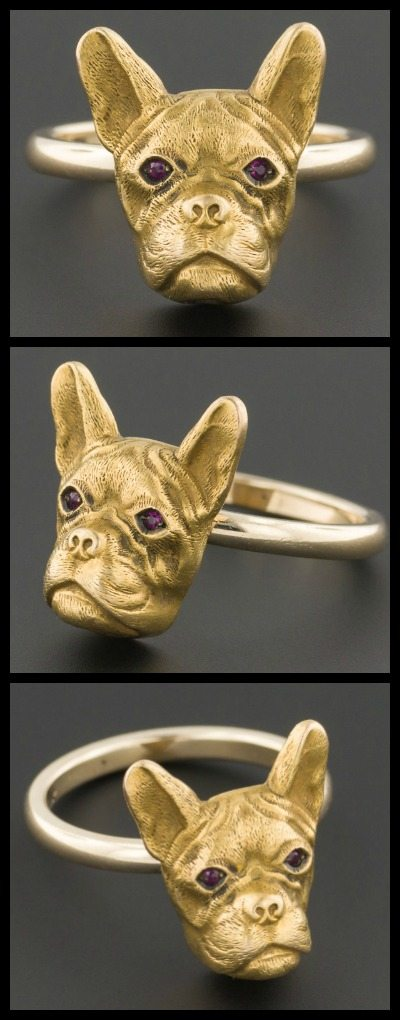 This sweet little guy was originally an antique stickpin. He's 14k gold with garnet eyes, and available at Trademark Antiques. Do you think he looks more like a French bulldog or a Boston terrier?