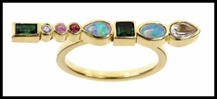 Stepping Stone ring by Ilana Ariel, with colorful gemstones and diamonds set in yellow gold.