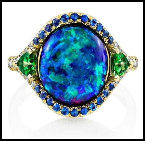 The award-winning Lighting Ridge black opal ring by Omi Privé, with diamonds, sapphires, and tsavorite garnet.