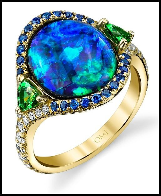 The prize-winning Lighting Ridge black opal ring by Omi Privé, with diamonds, sapphires, and tsavorite garnet.