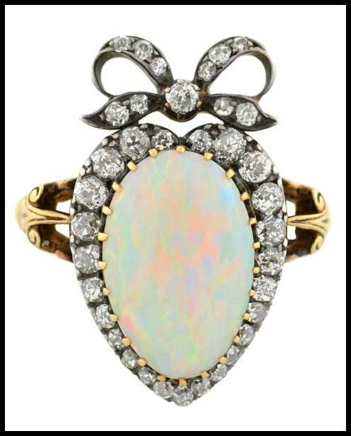 Victorian opal and diamond ring in 18k silver-topped-gold heart setting with a diamond-set bow; front view