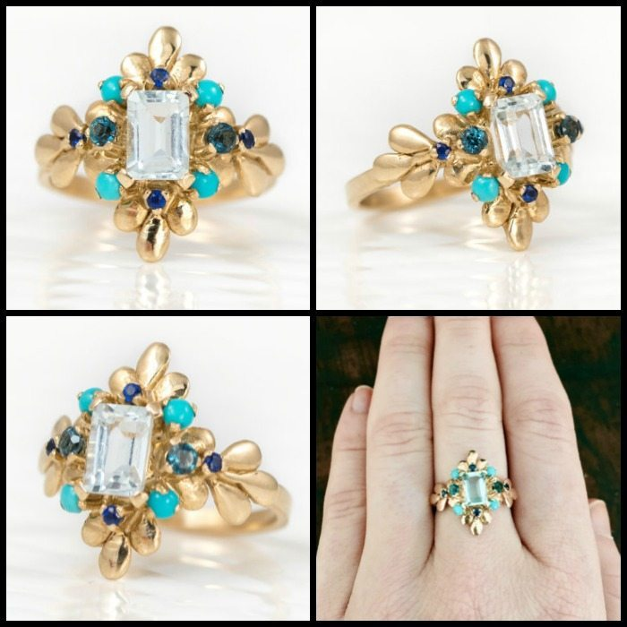 A Melanie Casey Wisteria ring in gold with an emerald cut aquamarine with sapphire, turquoise, and topaz embellishments.