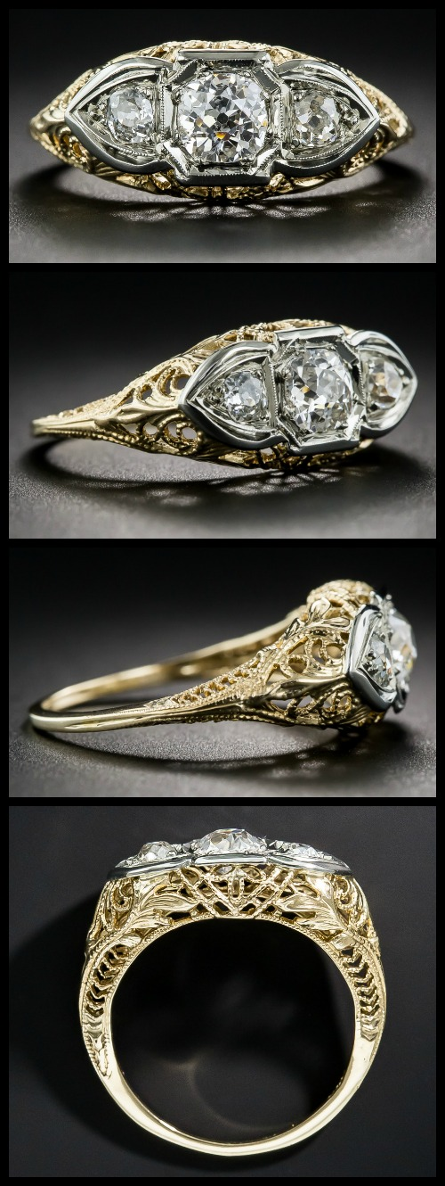 Beautiful antique Art Deco engagement ring in the three stone style, with a trio of diamonds set in intricate yellow and white gold filigree.