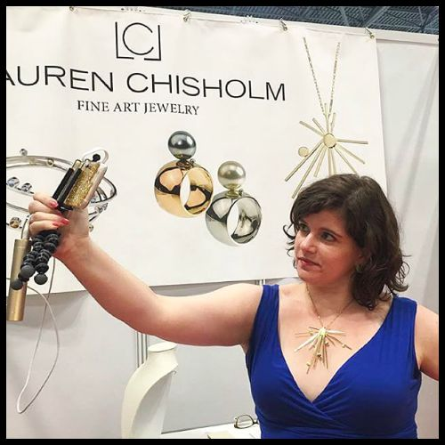 Becky of Diamonds in the Library attempting a selfie in a beautiful Lauren Chisholm Starburst necklace.