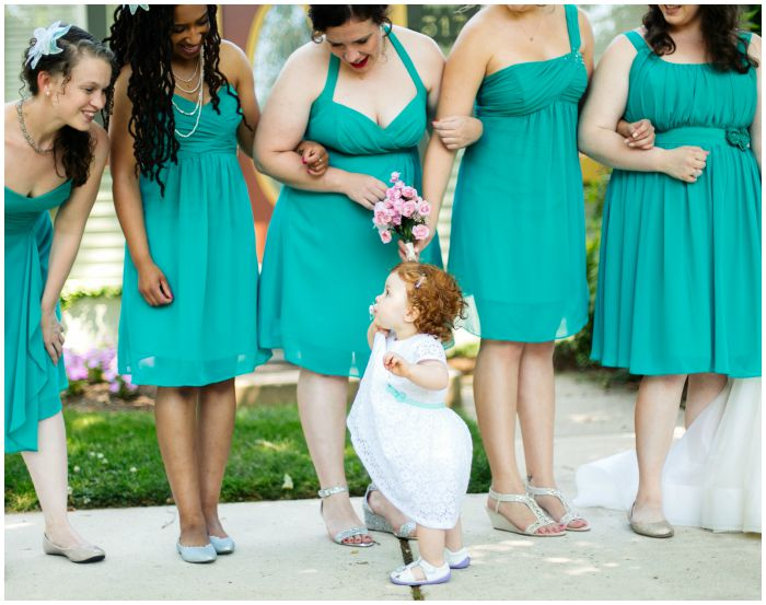 Our flower girl stealing the show. Photography by Angel Kidwell.