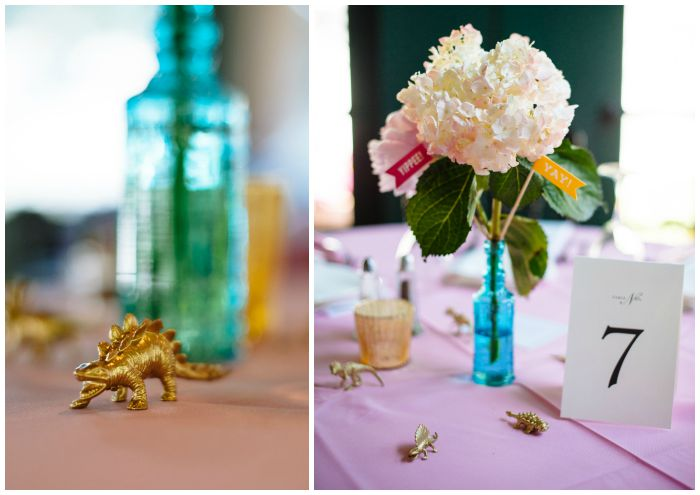 Our wedding decorations - yay flags and gilded dinosaurs. Photography by Angel Kidwell.