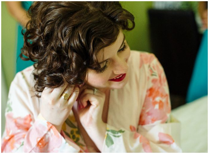 Putting on my wedding earrings from Lang Antiques.  Photo by Angel Kidwell.