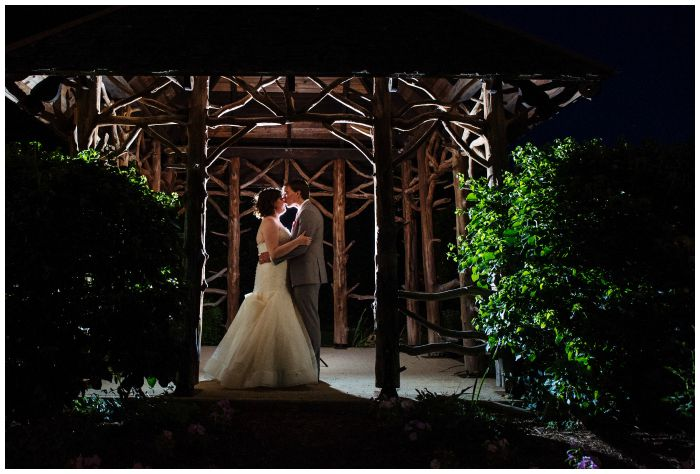 Stealing a quiet moment in the magical darkness outside the Vandiver Inn. Wedding photography by Angel Kidwell.
