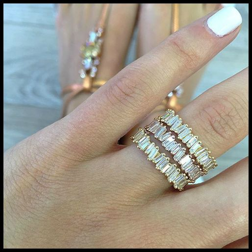 Suzanne Kalan baguette eternity rings in 18k gold and rose gold.