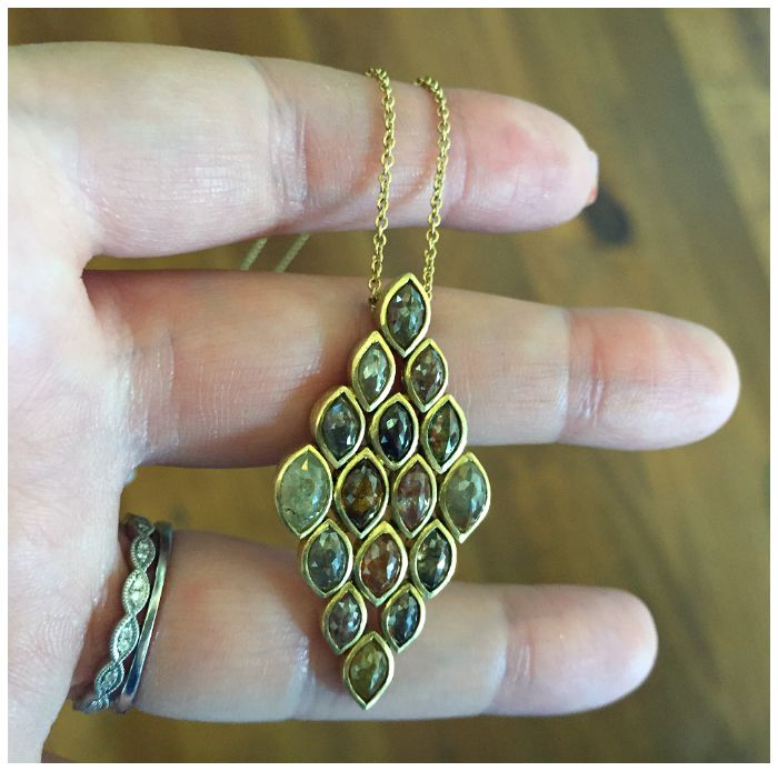 A stunning colored diamond necklace in gold from Todd Reed jewelry