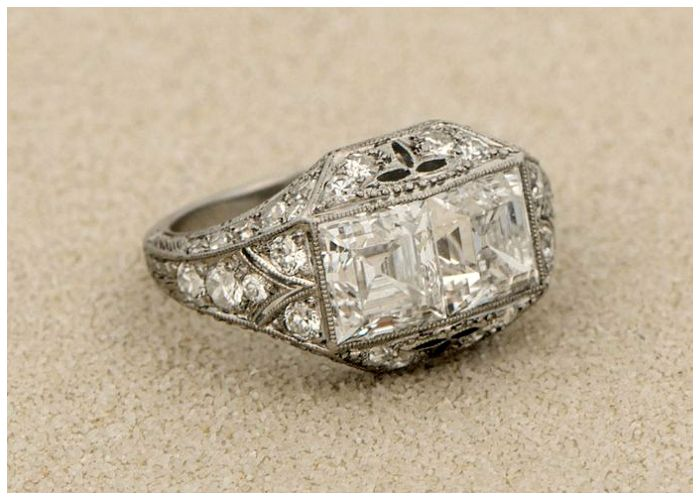 An antique Art Deco carré engagement ring with millegrain details and two 1.50 carat carre cut diamonds. Circa 1925.