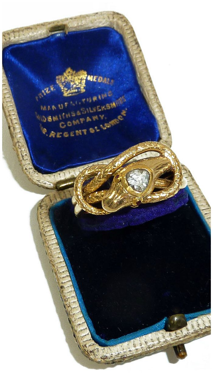 Antique snake ring in gold with a diamond head; Victorian from the late 19th century. At Antique Animal Jewelry.