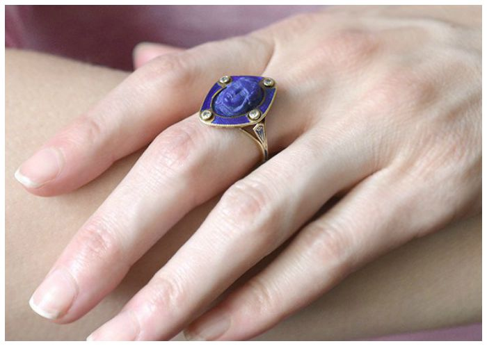 On the hand - an antique Victorian carved lapis ring with diamonds and blue enamel, circa 1800. From A Brandt and Son.