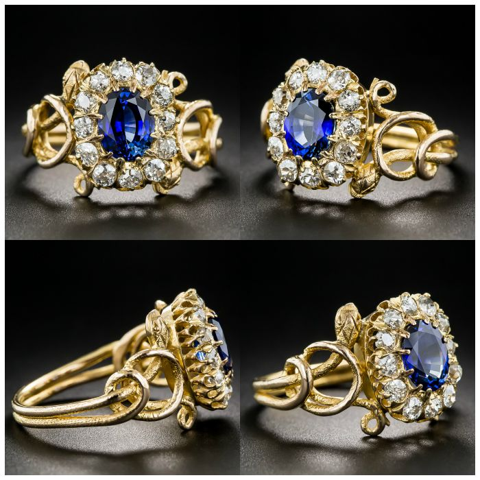 This antique snake ring from the Victorian era features a richly blue sapphire in a halo of diamonds, held by two twining, sinuous side serpents. At Lang Antiques.
