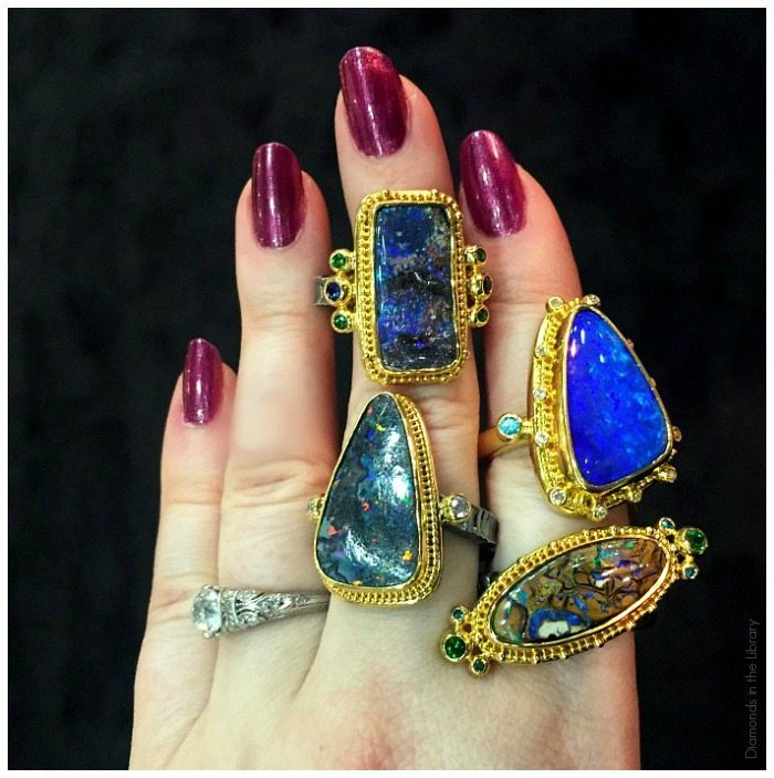 A handfull of opal rings by Zaffiro Jewelry