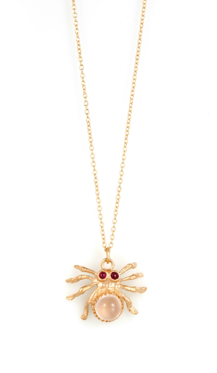 A moonstone and ruby spider necklace in gold by Anna Ruth Henriques