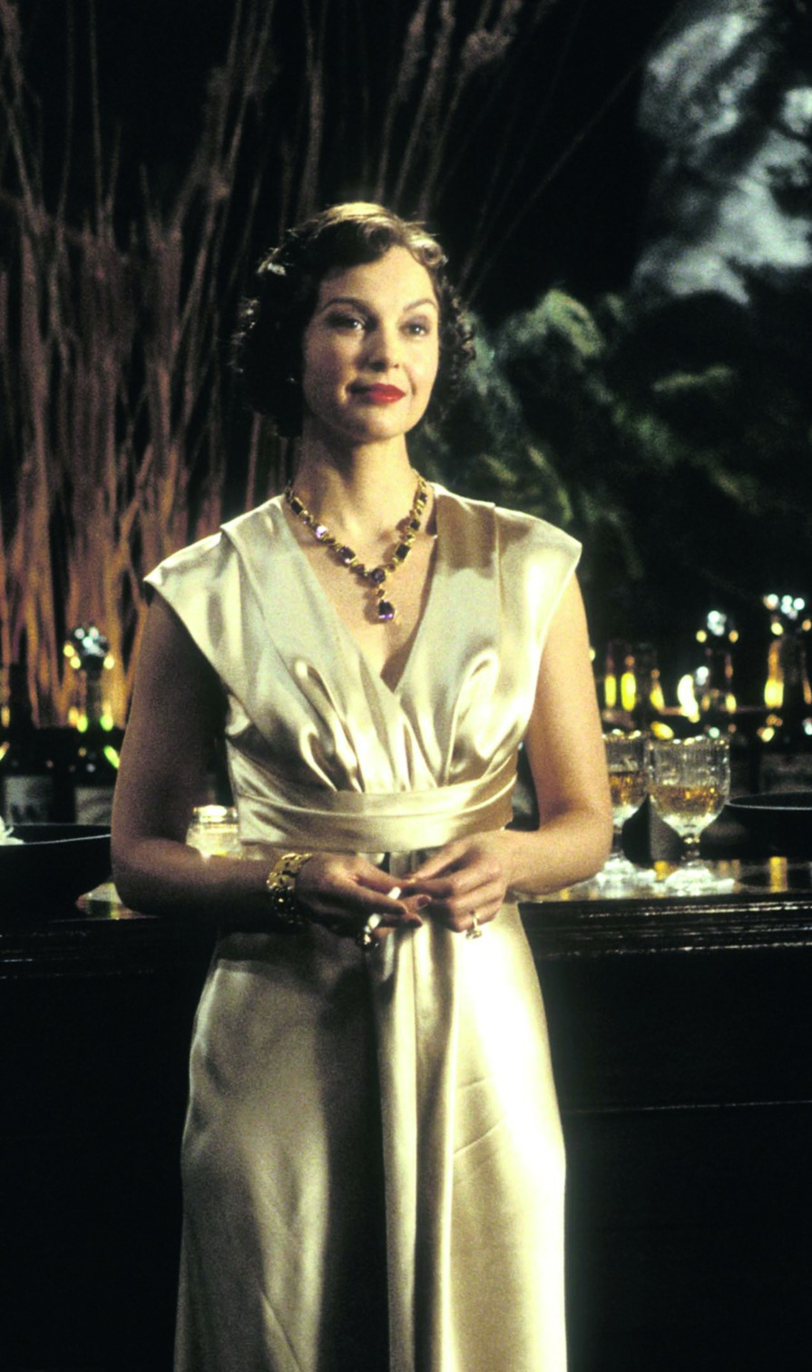 Ashley Judd wearing a gem-set necklace by Verdura on the set of the movie De-Lovely in 2004.