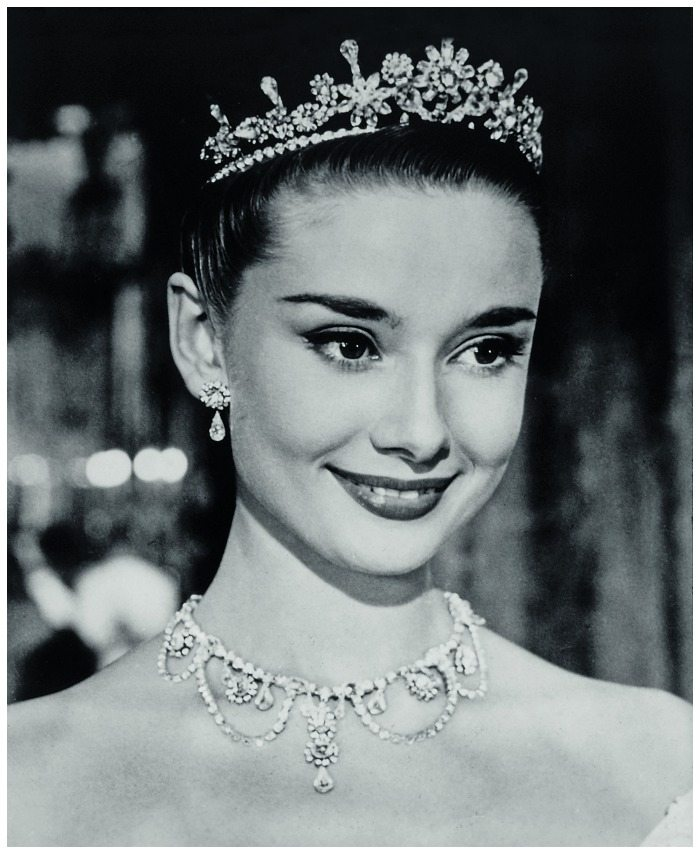 Audrey Hepburn wearing a necklace and tiara in a still from the 1953 film, Roman Holiday.