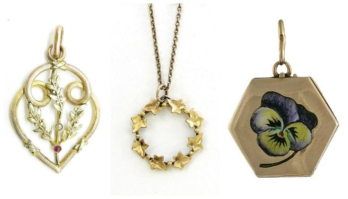 Three antique pendent necklaces in gold with floral themes, one with an enamel pansy.