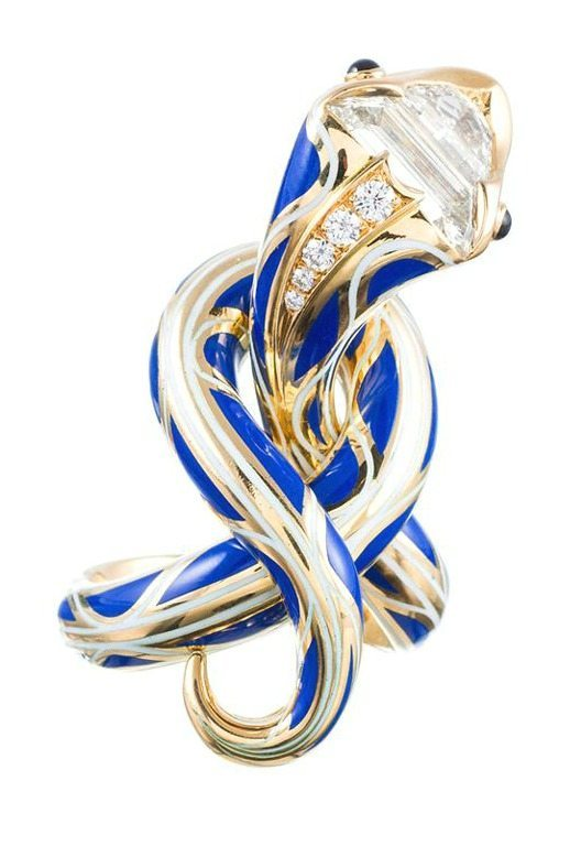 An enamel serpent ring by Juan daSilva in gold with blue enamel and fancy-cut diamonds.