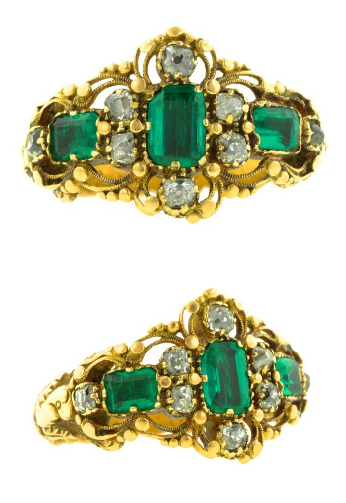 Antique Georgian Emerald and Diamond Ring in 18k and 10k gold. Three Emerald cut emeralds in an east west filigree design with eight antique cut diamonds weighing app. 0.30ctw. Closed back settings, circa 1830.