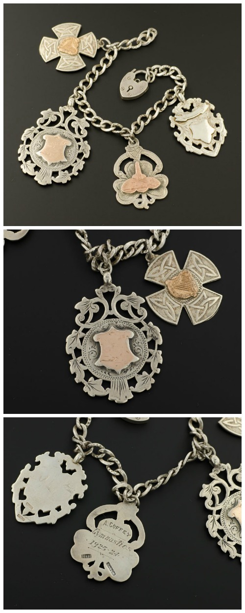 Antique sterling silver charm bracelet with antique mixed metal medallions.