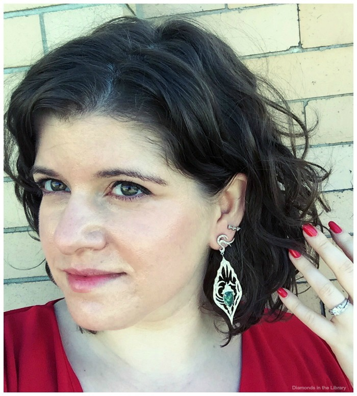 Becky of Diamonds in the Library test driving a pair of Annie Fensterstock earrings with 3.60 carats of emeralds in diamonds