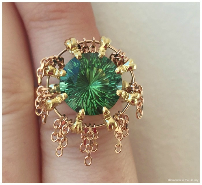 Detail shot of a yellow and rose gold ring by William Travis Jewelry with a 4.99 ct green tourmaline.