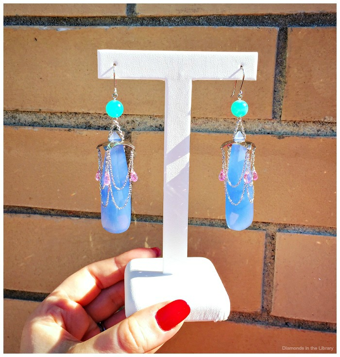 Earrings from William Travis Jewelry; blue chalcedony with pink sapphires and opals.