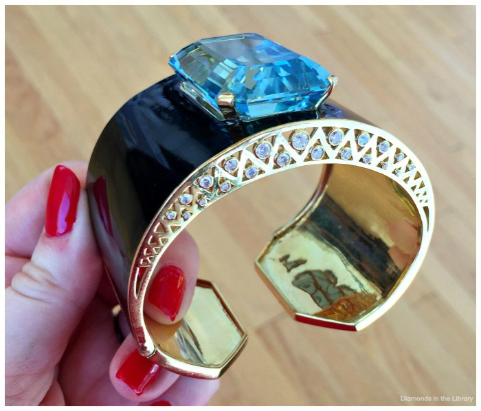 Eclat Jewels' cuff bracelet with a 105 ct aquamarine in 18k yellow gold and black enamel.