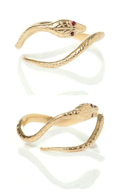 Gold antique-inspired Ouroboros snake ring with ruby eyes