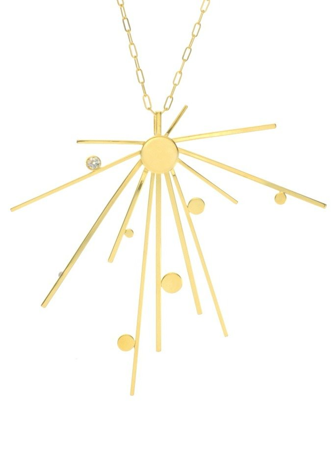 Lauren Chisholm's gold starburst 3 pendant necklace in solid 14k gold with a diamond.