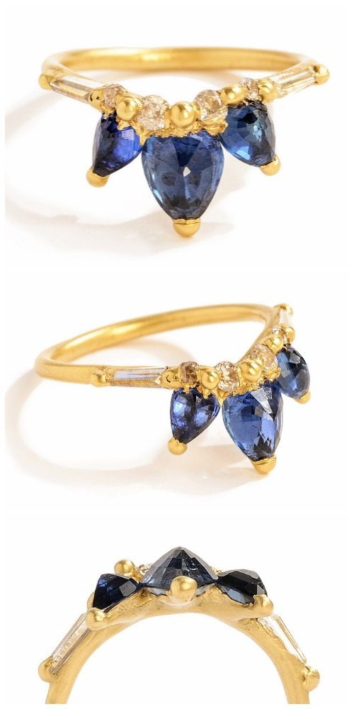 Polly Wales Fleur de Lys sapphire halo V ring in yellow gold with diamonds.
