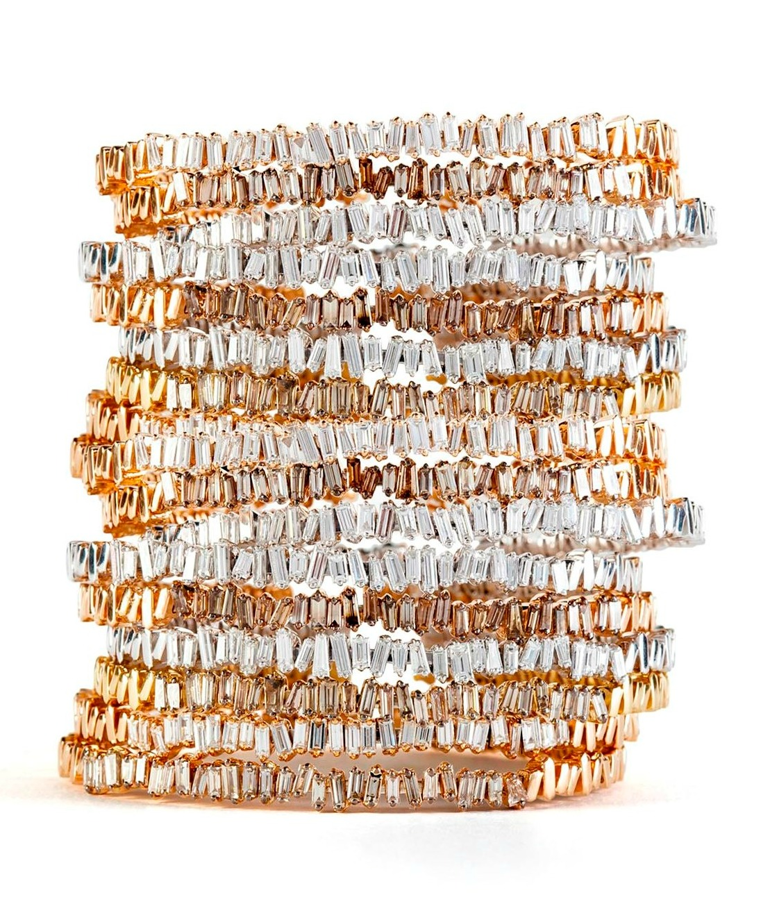 Suzanne Kalan's Firework bangles with diamond baguettes in gold.