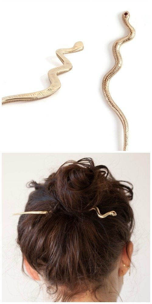 The Mokao snake hairpin by Leo Black. In brass, with garnet eyes.