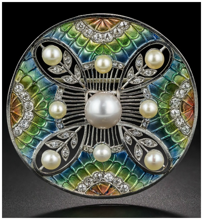 An ntique Belle Epoque plique-a-jour enamel brooch with pearls and diamonds.