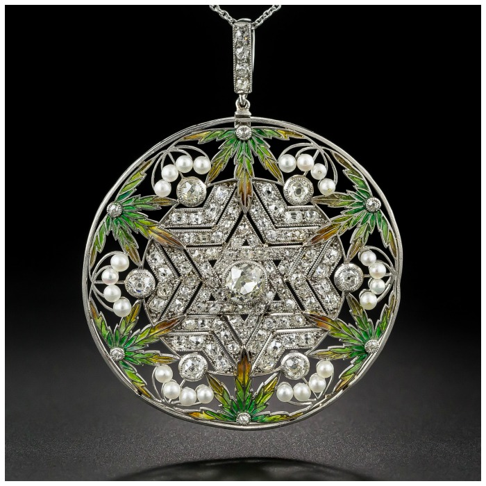 An unusual Belle Epoque plique-a-jour enamel and diamond pendant with a Star of David.