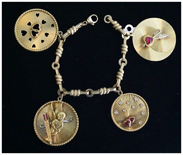 A bold, retro gold Tiffany and Co charm bracelet with romantic charms. At Keyamour.