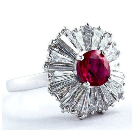 A ballerina ring ring with a 1.86 carat cushion cut ruby center and three carats of diamonds.