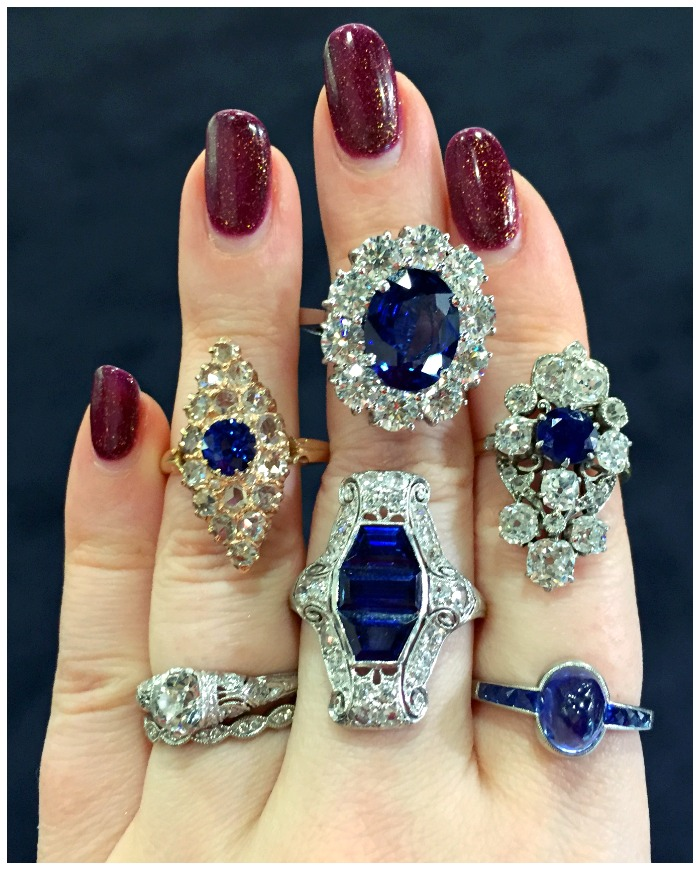 A hand full of antique sapphire and diamond rings from Craig Evan Small.