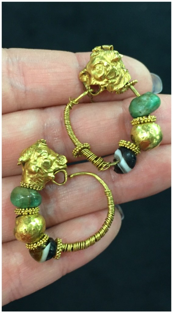 A pair of ancient gold earrings from S.J. Shrubsole.