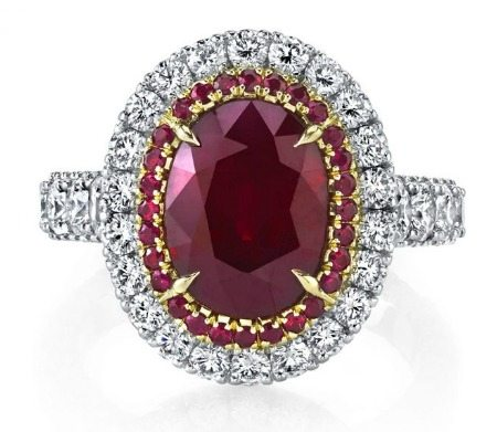 A ruby ring by Omi Prive with a 5 carat ruby and pave diamonds in platinum and rose gold.