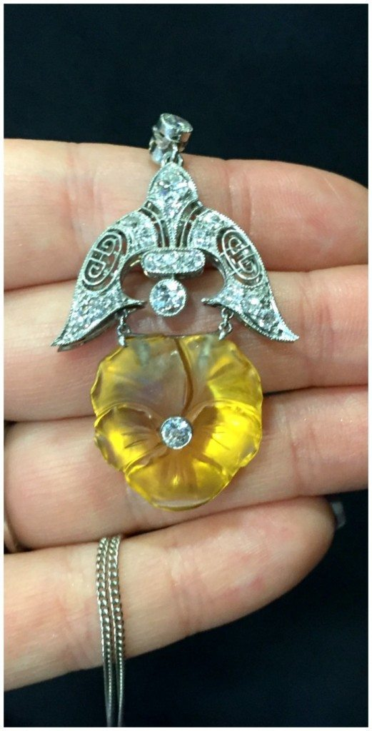 An incredible antique Art Deco pendant with diamonds in platinum and a beautiful carved citrine pansy. From Platt Boutique Jewelry.