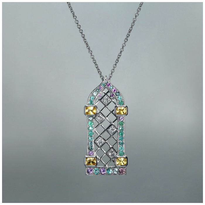 Maria Kodavi's Venetian Window pendant with Paraiba tourmalines, sapphires, topaz, and diamonds in 18kt gold.