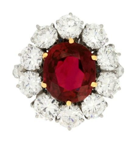 This retro ruby ring from 1960 boasts a gorgeous 6.19 carat center stone accented by 4.4 carats of diamonds.