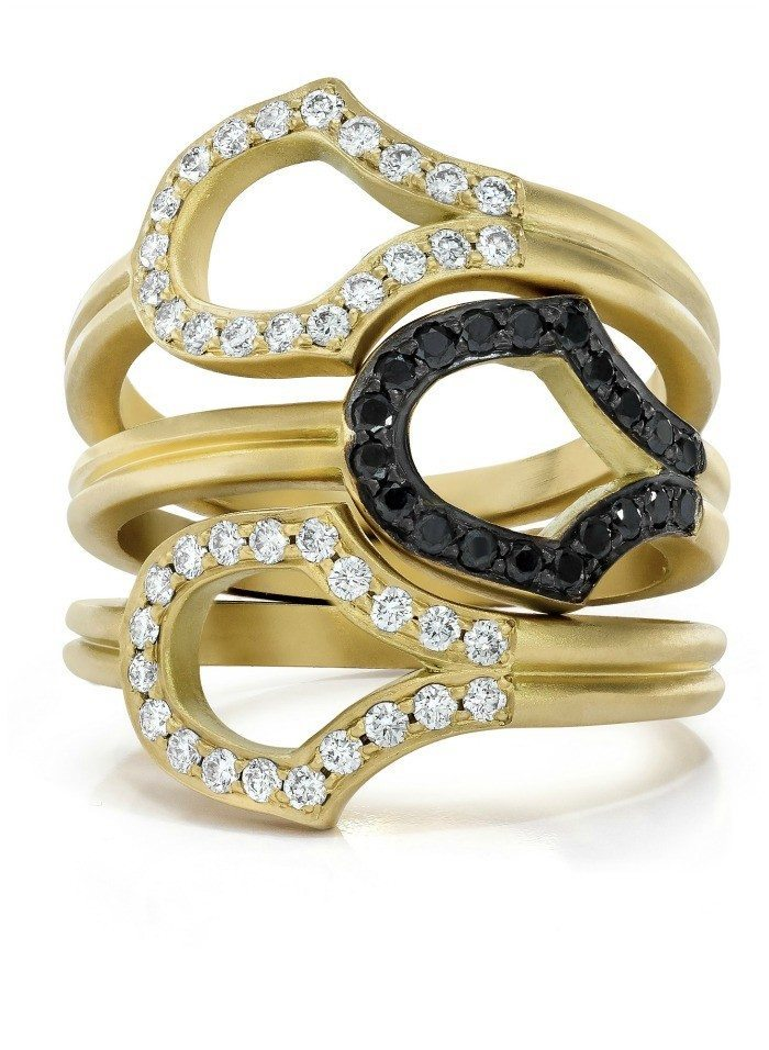 The Doryn Wallach Scale rings in gold with black or white diamonds